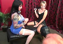 Two femdom Mistresses torment dirty pervert