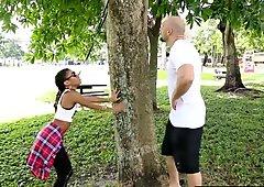 Flexible ebony teen bounces on white cock