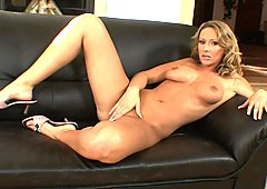 Shaved Roxy Carter masturbates her hot juicy cunt in solo action