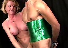 Blonde domina giving her gimp fellow a hand-job