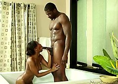 Chocolate well packed masseuse gets poked in the bathroom