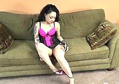 Tattoed brunette sitting on meat pole