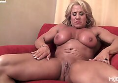 Blonde mature muscle chick shows off big clit