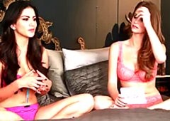 Talkative busty brunette Sunny Leone chats while wearing pink lingerie