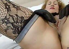 Voluptuous cougar rubs her craving cunt