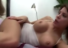Hot lesbians fucks a dildo with babe helping her