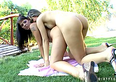 Hot blonde lesbian Peaches spreading her pussy for Simony outdoors