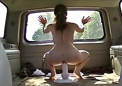 Riding a big dildo naked in back of Suburban while driving around