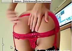 Class cam girl in her red garter belt