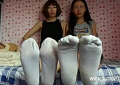 2 japanese women under sneakers
