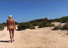 Girl walkes outdoors in the sun part 2