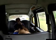 Brit amateur sucking cock in a taxi