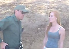 Pale redhead riding border guard cock outdoors