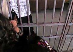 Bitchie nymphos in blouses squat down to suck dicks through prison bars