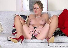 Big tits brunette milf Sofia Rae unwraps and strokes in nylons and fancy heels